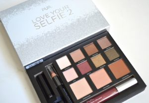 """Love Your Selfie 2 """"Day to NIght Collection"""" includes 8 eyeshadows in matte and shimmer textures, glow highlighter, matte bronzer, setting powder, creamy lip pencil, high-shine lip-plumping gloss and fully charged mascara."""