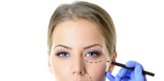 Woman having cosmetic enhancement